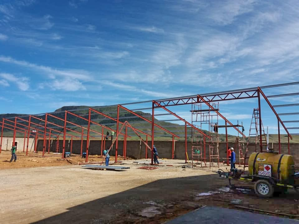 Workers erecting a steel structure